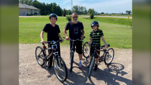 Zack Graves (left), Derek Graves (centre) and Adam Graves received bicycles from The Bike Bank project in Pembroke, Ont. (Dylan Dyson/CTV News Ottawa)
