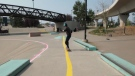 Neon tape, textured pathways and audio signals all made it possible for blind and visually impaired skateboarder to ride at Calgary's Shaw Millennium Park on Saturday.