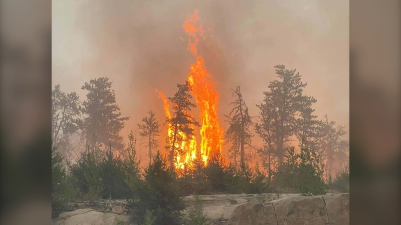 A wildfire burns near Bloodvein First Nation in Manitoba in July 2021. (Source: Frank Young)