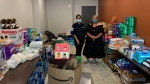 Virginia Thomas (right) collects donations on July 24, 2021, for families evacuated from Bloodvein First Nation due to wildfires and smoke. (Submitted: Virginia Thomas)