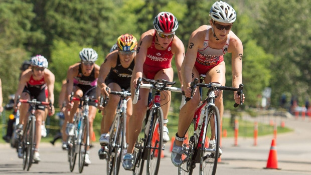 Lauren Campbell leads the second pack during the bike portion of the Edmonton ITU Triathlon World Cup in Edmonton on Sunday, July 8, 2012. (AP Photo/ITU, Arnold Lim)