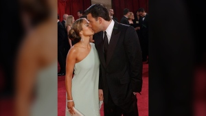 Actors Jennifer Lopez and her then fiance Ben Affleck kiss during their arrival for the 75th annual Academy Awards in this March 23, 2003 taken in Los Angeles. (AP Photo/Kim D. Johnson)