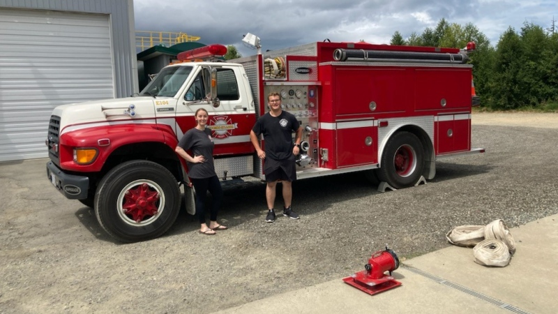 Firefighters Jenny Jones and Zach Mosher pose with Coombs Tender Unit 104. (Regional District of Nanaimo)