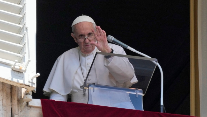 Pope Francis waves to the crowd as he leaves after delivering the Angelus noon prayer from the window of his studio overlooking St. Peter's Square, at the Vatican, Sunday, July 18, 2021. (AP Photo/Alessandra Tarantino)