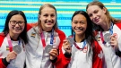 Canada's Margaret Mac Neil, left to right, Rebecca Smith, Kayla Sanchez and Penny Oleksiak celebrate a silver medal in the women's 4 x 100m freestyle relay during the Tokyo Olympics in Tokyo, Japan on Sunday, July 25, 2021. THE CANADIAN PRESS/Frank Gunn