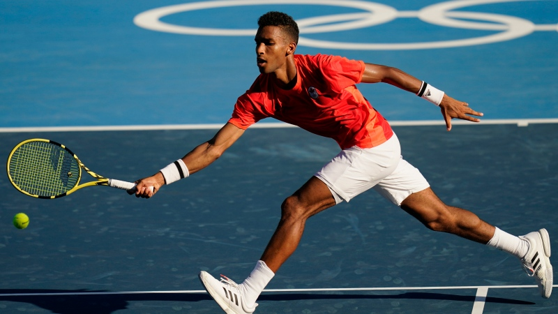 Felix Auger-Aliassime, of Canada, plays against Max Purcell, of Australia, during the first round of the tennis competition at the 2020 Summer Olympics, Sunday, July 25, 2021, in Tokyo, Japan. (AP Photo/Seth Wenig)