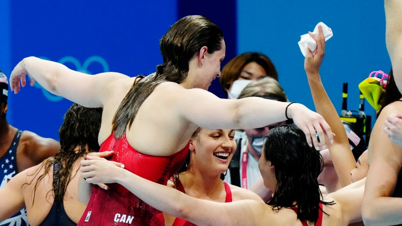Canada's Penny Oleksiak, Rebecca Smith, Kayla Sanchez and Margaret Mac Neil celebrate a silver medal in the women's 4 x 100m freestyle relay during the Tokyo Olympics in Tokyo, Japan on Sunday, July 25, 2021. (THE CANADIAN PRESS/Frank Gunn )
