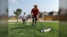 Sher Braun leads approx 30 volunteers in cleaning up nails and glass and metal from lawns in the worst hit areas of the tornado on Sun. July 25, 2021 (David Sullivan/CTV News Barrie)