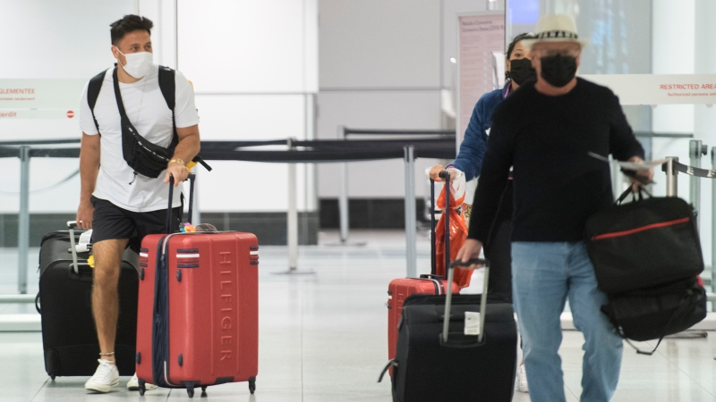 Passengers will no longer be sorted based on vaccination status at Pierre-Trudeau International Airport in Montreal. THE CANADIAN PRESS/Graham Hughes