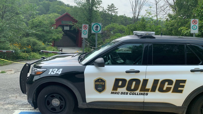 MRC des Collines police at the Wakefield Covered Bridge, Sunday, July 25, 2021. Police say a man disappeared in the Gatineau River while swimming with friends. (Jackie Perez / CTV News Ottawa)