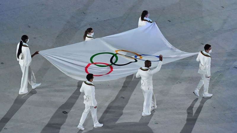 The Olympic flag is seen being carried during the opening ceremony of the Tokyo 2020 Olympic Games at the Olympic Stadium in Tokyo on July 23. (Antonin Thuillier/AFP/Getty Images)