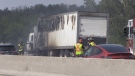A tractor-trailer is engulfed in flames on Highway 400 north of Cookstown on Sunday, July 25 (Dave Sullivan/CTV News)