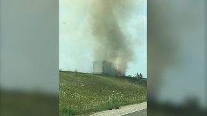 A tractor-trailer engulfed in flames on Highway 400 on Sunday, July 25 (Courtesy of Shelby Mercer)