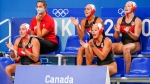 Team Canada water polo players cheer during preliminary play against Australia at Tatsumi Water Polo Centre during the Tokyo 2020 Olympic Games on Saturday, July 24, 2021. (THE CANADIAN PRESS/HO, COC, Darren Calabrese)