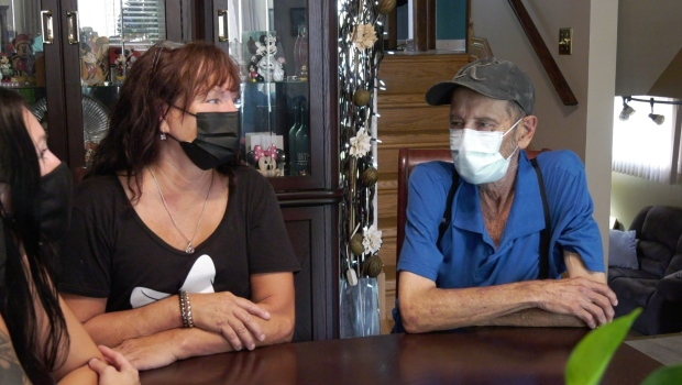 Cindy Reaume sitting down with her husband. (Bob Bellacicco/CTV News)