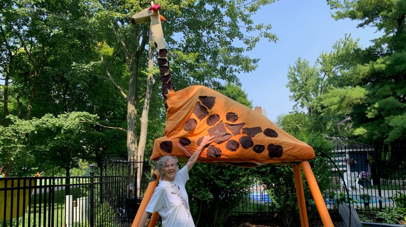 Anne Innis Dagg stands in front of Spot the Giraffe in Waterloo, meant to highlight her many years of work studying and education people about the animal. (Jessica Smith/CTV Kitchener) (July 25, 2021)