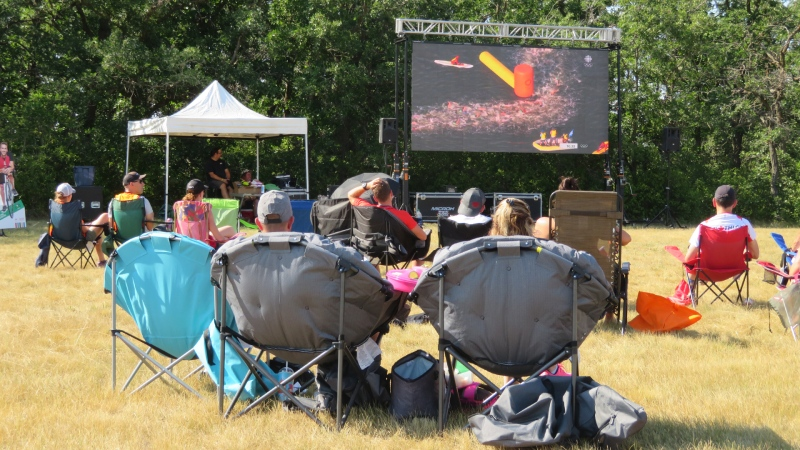 A crowd of more than 100 fans gathered at Birds Hill Provincial Park on Sunday evening to cheer on Tyler Mislawchuk of Oak Bluff, Man., as he competed in this year's triathlon event at the Tokyo Olympics. (Supplied: Triathlon Manitoba)