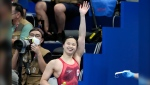 Margaret (Maggie) Mac Neil, of Canada, reacts after winning the final of the women's 100-metre butterfly at the 2020 Summer Olympics, Monday, July 26, 2021, in Tokyo, Japan. (AP Photo/Petr David Josek)
