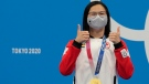 Canada's Margaret Mac Neil poses with the gold medal after winning the women's 100-meter butterfly at the 2020 Summer Olympics, Monday, July 26, 2021, in Tokyo, Japan. AP Photo/Petr David Josek