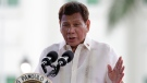 Philippine President Rodrigo Duterte gestures as he delivers his speech during the 123rd anniversary of the proclamation of the Philippine independence rites on Saturday, June 12, 2021, at the Provincial Capitol of Bulacan province, Philippines. (AP Photo/Aaron Favila)