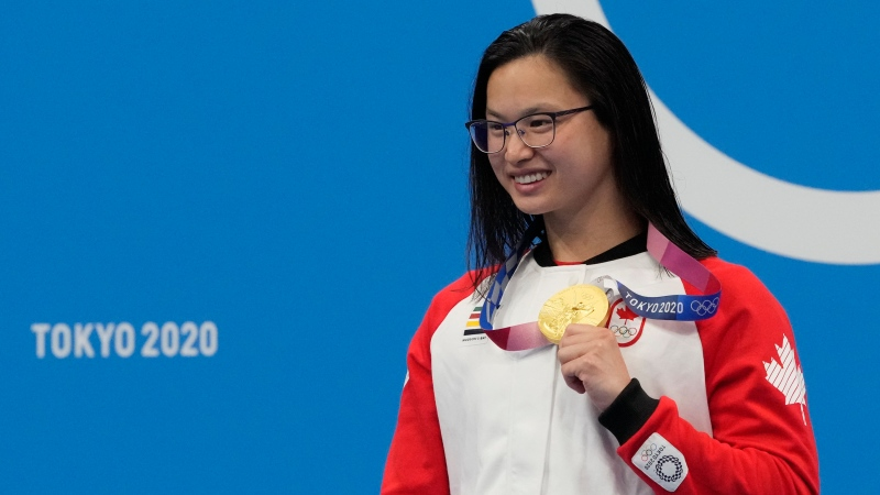 Canada's Margaret Mac Neil poses with the gold medal after winning the women's 100m  butterfly at the 2020 Summer Olympics, July 26, 2021, in Tokyo, Japan. (AP Photo/Petr David Josek)