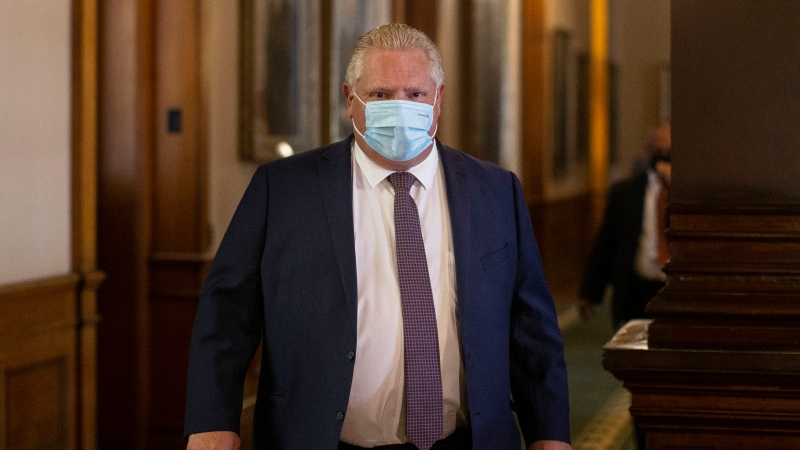 FILE- Ontario Premier Doug Ford walks into the Legislative chamber at Queens Park, in Toronto, on Monday June 14, 2021. A vote is expected this afternoon on legislation that would limit third-party advertising during Ontario elections. THE CANADIAN PRESS/Chris Young