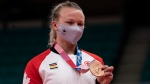 Canada's Jessica Klimkait poses for photographers after winning the bronze medal in women's 57kg judo competition at the Tokyo Olympics, Monday, July 26, 2021 in Japan. THE CANADIAN PRESS/Adrian Wyld