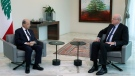 In this photo released by Lebanese government, Lebanese President Michel Aoun, left, meets with former Lebanese Prime Minister Najib Mikati, at the presidential palace, in Baabda, east of Beirut, Lebanon, on July 26, 2021. (Dalati Nohra / Lebanese Official Government via AP)