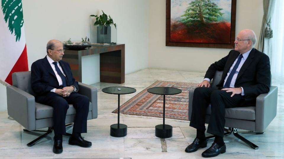 Michel Aoun, left, meets with Najib Mikati