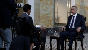 Iraqi Prime Minister Mustafa al-Kadhimi sits during an interview with The Associated Press in Baghdad, Iraq, Friday, July 23, 2021.