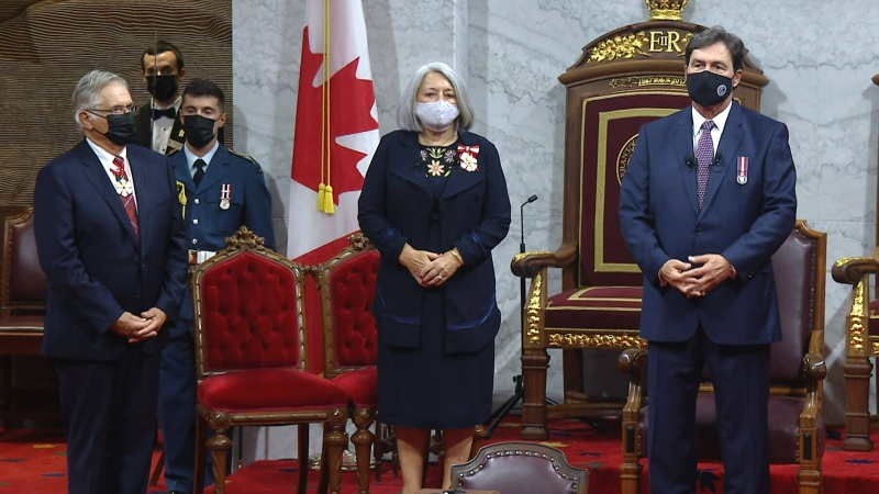 Mary Simon, centre, arrives in the Senate Chamber before she is installed as Canada's 30th governor general, Monday, July 26, 2021.