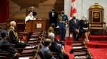 Elder Claudette Commanda (top left) speaks during the installation of Mary Simon (top right) as governor general of Canada in Ottawa on Monday, July 26, 2021. THE CANADIAN PRESS/Paul Chiasson