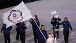 In this file photo taken Friday, Feb. 9, 2018, Taiwanese athlete Lien Te-An carries the Chinese Taipei flag representing Taiwan during the opening ceremony of the 2018 Winter Olympics in Pyeongchang, South Korea. (AP Photo/Michael Sohn, File)