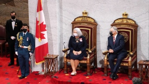 Mary Simon and her husband Whit Fraser look on after she took the oath to become the 30th Governor General of Canada in Ottawa on Monday, July 26, 2021. THE CANADIAN PRESS/Sean Kilpatrick