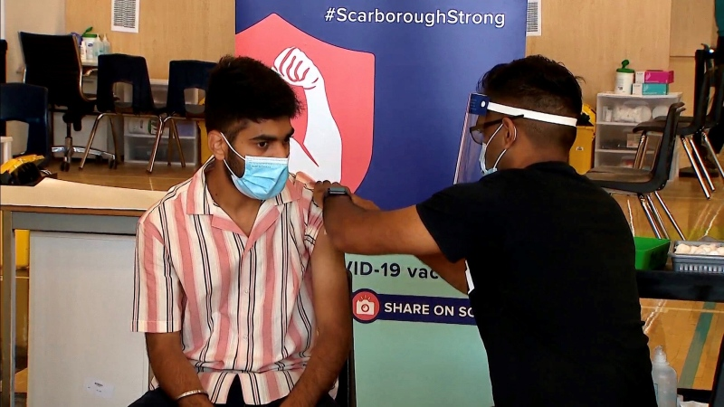 Karanjeet Singh gets a dose of COVID-19 in Scarborough on July 26, 2021.