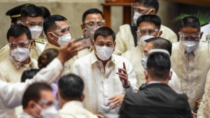 Philippine President Rodrigo Duterte is surrounded by security at the House of Representatives in Quezon City, Philippines on July 26, 2021. (Jam Sta Rosa / Pool Photo via AP)