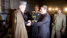 Afghan President Hamid Karzai, center left, shakes hand with Pakistan's President Asif Ali Zardari, center right, at the presidential palace in Kabul, Afghanistan, Wednesday, Nov. 18, 2009.  (AP / Musadeq Sadeq)