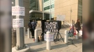Protesters outside the Calgary Courts Centre calling for the firing of Const. Alex Dunn.