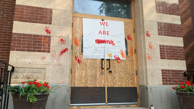 A photo shows a defaced sign at St. Paul's  Co-Cathedral in Saskatoon. (Ryan Fletcher/CTV News)