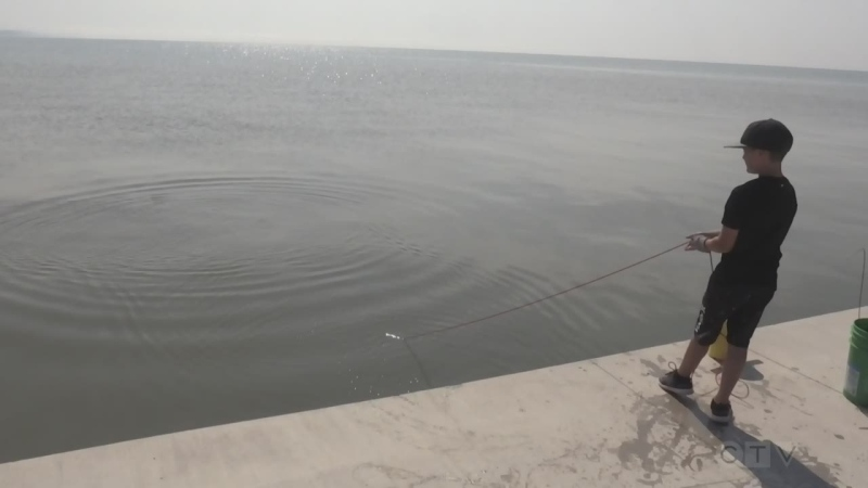 Boy magnet fishing on Lake Erie's bombshell find