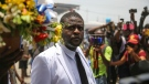 """Jimmy Cherizier, alias Barbecue, a former police officer who heads a gang coalition known as """"G9 Family and Allies, leads a march to demand justice for slain Haitian President Jovenel in Lower Delmas, a district of Port-au- Prince, Haiti Monday, July 26, 2021. (AP Photo/Joseph Odelyn)"""