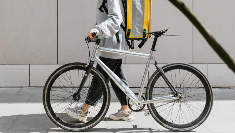 A person is seen walking a bike in this undated file photo. (Pexels)