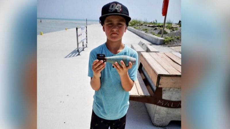 Boy magnet fishing on Lake Erie