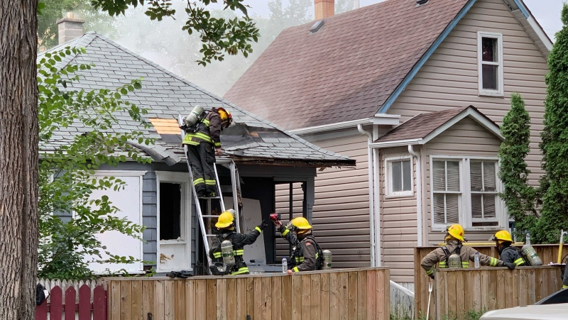 Winnipeg Fire Paramedic Service (WFPS) on the scene of a house fire in the 500 block of Toronto Street in Winnipeg on July 26, 2021. (Source: Jamie Dowsett/ CTV News Winnipeg)