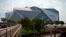 The Mercedes-Benz Stadium is seen, Monday, July 26, 2021, in Atlanta, Georgia. (AP Photo/Ron Harris)