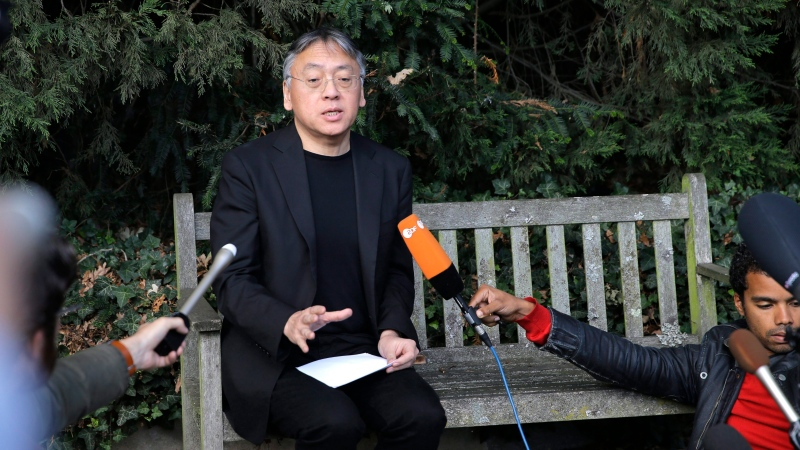 In this file image, British novelist Kazuo Ishiguro speaks during a press conference at his home in London, Thursday Oct. 5, 2017. (AP Photo/Alastair Grant)