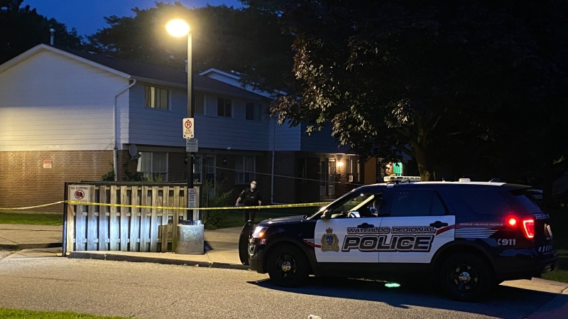 Officers taped off a parking lot of a townhouse complex on Rutherford Drive and canvassed the area on Monday evening. (Terry Kelly/CTV Kitchener)