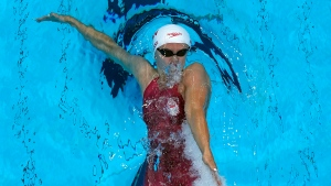 Canada's Kylie Masse competes in a 100-metre backstroke heat at the 2020 Summer Olympics, Sunday, July 25, 2021, in Tokyo. (AP Photo/David J. Phillip)