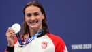 Kylie Masse of Canada poses with her silver medal for the women's 100-meter backstroke at the 2020 Summer Olympics, Tuesday, July 27, 2021, in Tokyo, Japan. (AP Photo/Matthias Schrader)