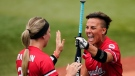 Canada's Larissa Franklin, left, celebrates with Jenn Salling who just scored during a softball game against Mexico at the 2020 Summer Olympics, July 27, 2021, in Yokohama, Japan (AP Photo/Matt Slocum)
